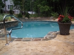 raleigh fiberglass pool with stone coping